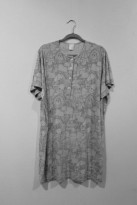 Greyscale. A dress on a hanger with bold geometric animal patterns.