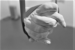 Two clasped hands made of white plaster.