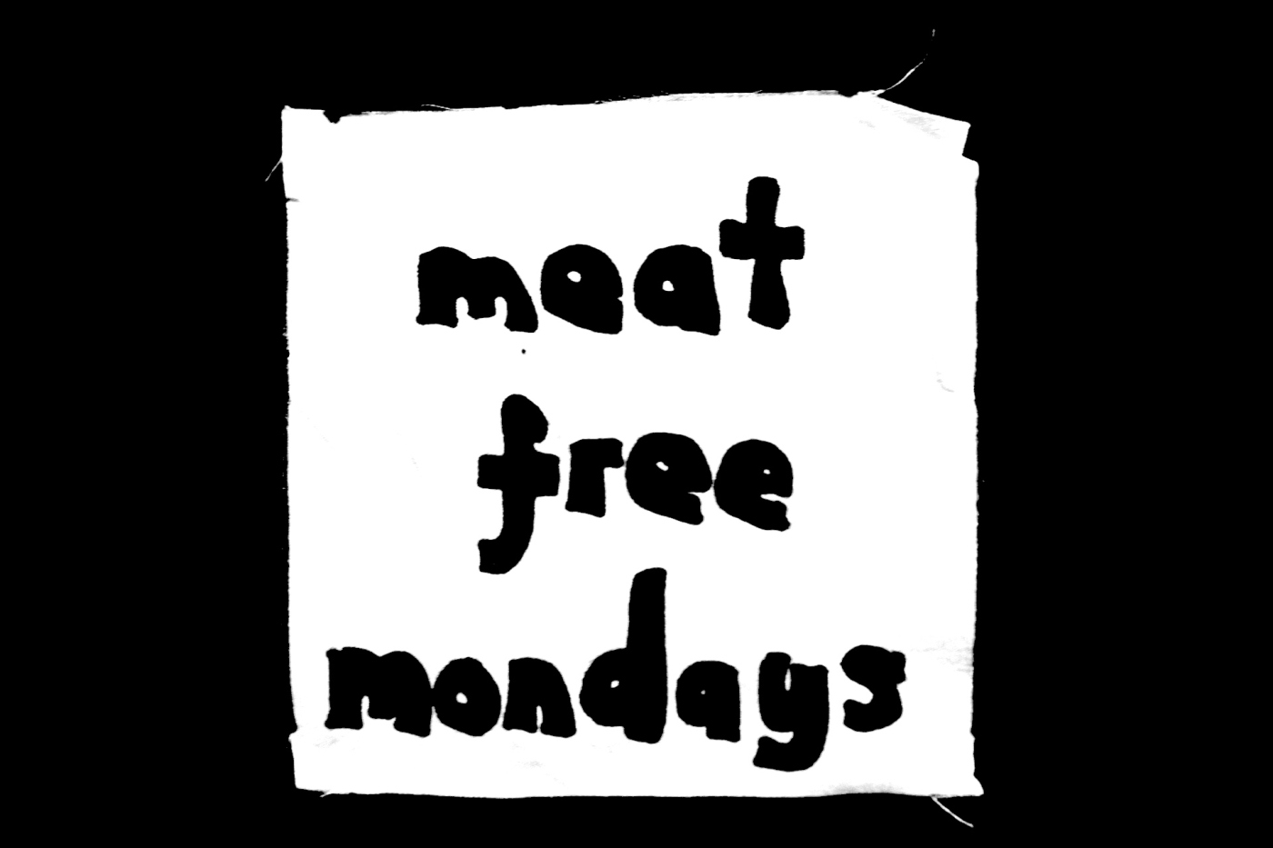 """Greyscale. A patch made by Ana Hine, reading """"meat free mondays."""""""