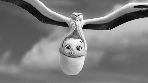 Greyscale. A still from the film 'Storks' in which a stork is carrying a baby through the air.