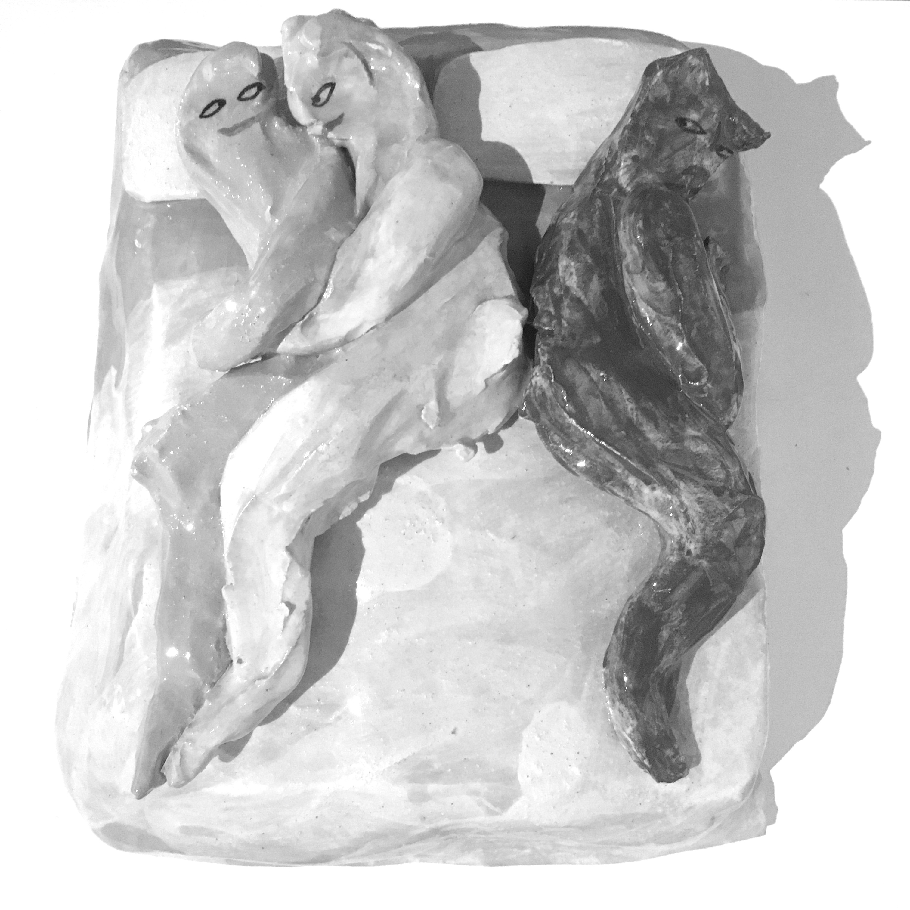 A clay model of a double bed and two people spooning on it, while another person is turned the other way.