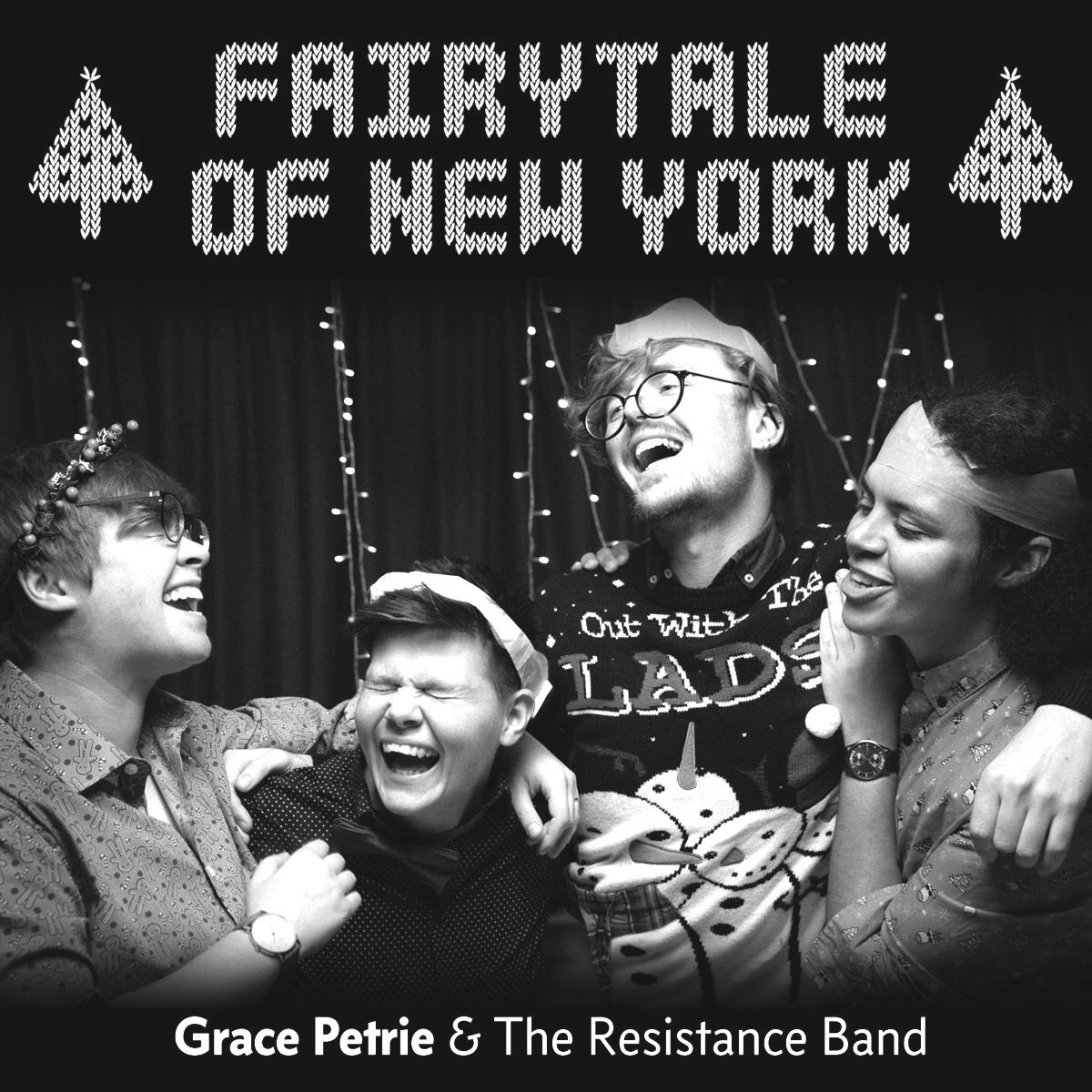 "Greyscale. The album cover for Grace Petrie and The Resistance Band's ""Fairytale of New York"" featuring a group of people laughing together in front of fairy lights."