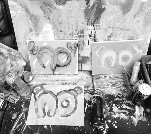 """Greyscale. Paintings of the word """"no"""" written in speech-marks in bubble writing."""