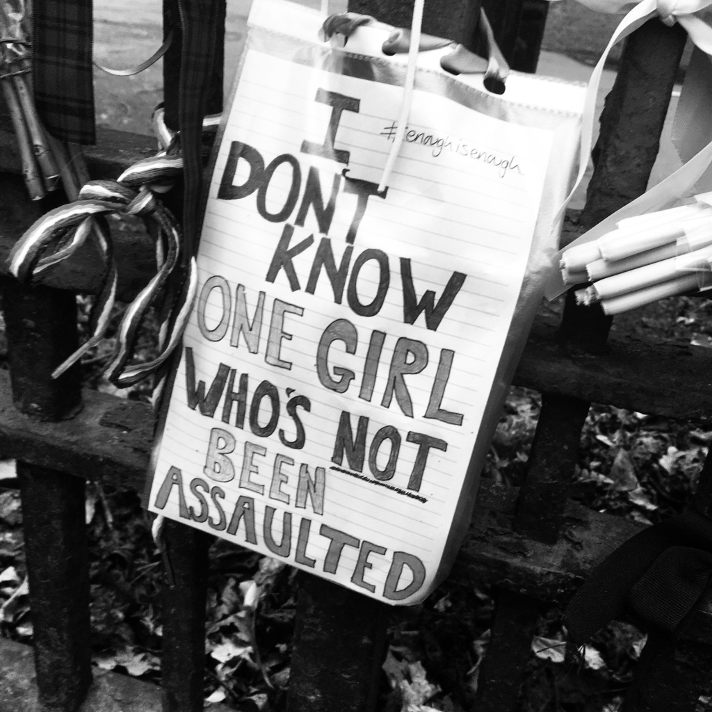 a note tied to a park gate, reads I Don't Know One Girl Who's Not Been Assaulted