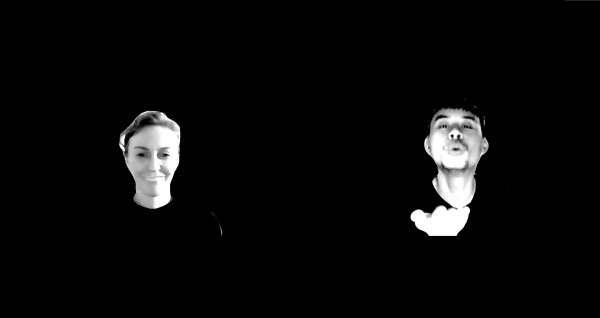 Against a black screen two people's heads hover in digital space. On the left a woman, Skye, smirks as she stares into the camera, while on the right a man blows a kiss to the audience.