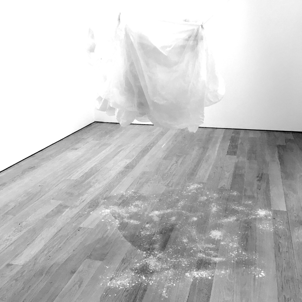 a sheet of polythene floats in the air in the aptly titled Small Gallery, suspended from the ceiling by almost invisible threads. Underneath it lies plaster powder – as if rain from some magical cloud.