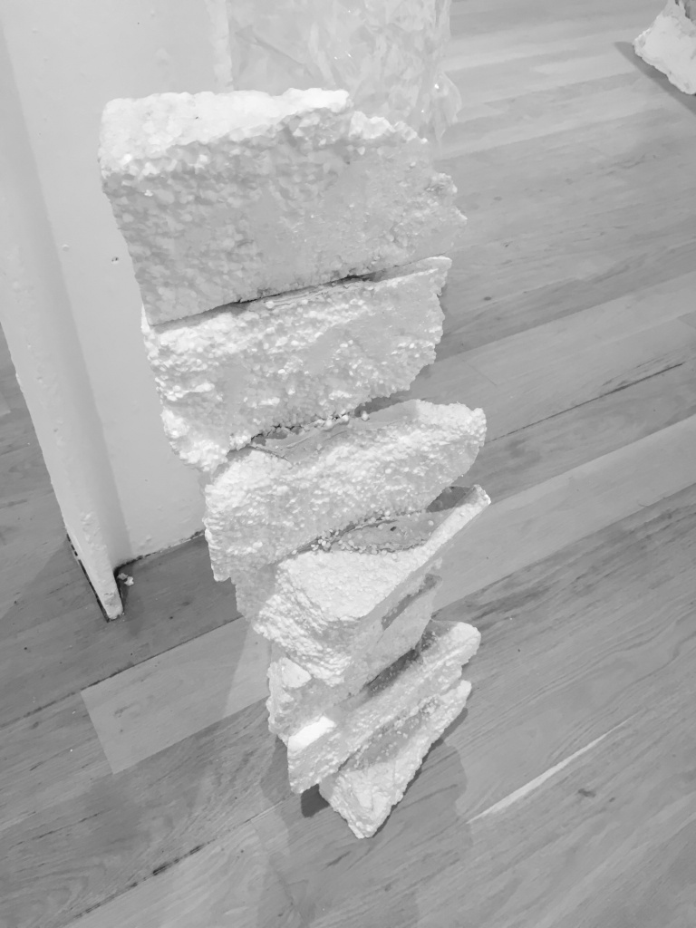 A stack of polystyrene wedges, like slices of a cake, with paste like icing pressed between each one.